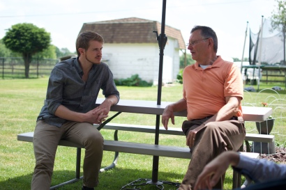Micah chats with Tom at the pastor's house