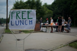 Sojourn and Finley youth serve lunch on the street to people passing by