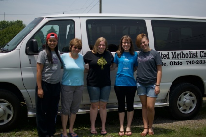 Sojourn girls pose with their host family before heading out