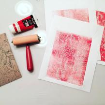 Test print of a floral pattern linocut.
